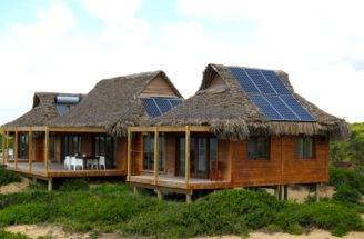 Awe Inspiring Thatched Mozambique Home Draped Solar Panels House