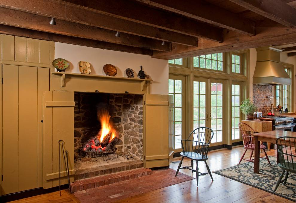 traditional ceiling beams over wooden fireplace screen