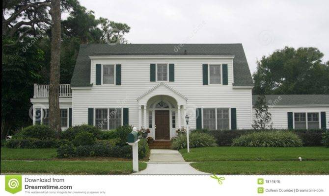 White Traditional American Style Home Withgreen Shutters Gable Roof