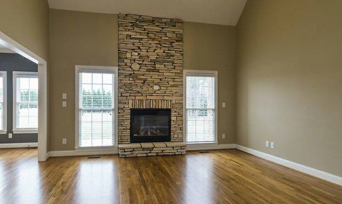 Floor Ceiling Stacked Stone Fireplace Flanked Windows