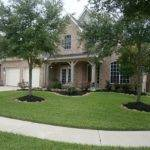 Front House Large Corner Lot Pretty Landscaping