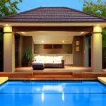 Ground Pool Design Using Stone Cabana Decorative Lighting