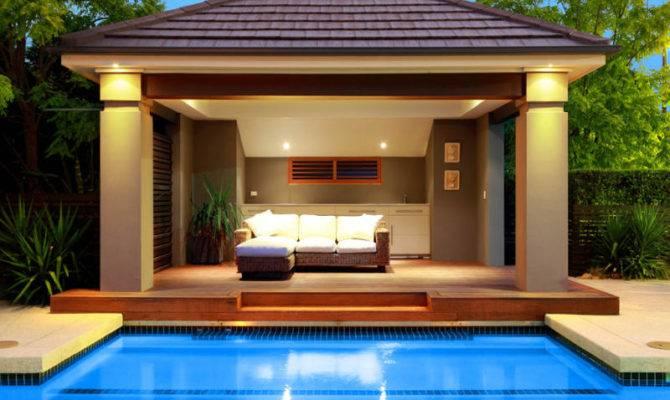 Ground Pool Design Using Stone Cabana Decorative Lighting