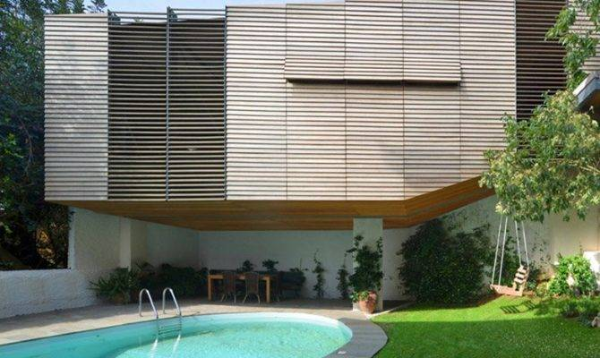 Hiboux Architects Hangs Garage Above Swimming Pool