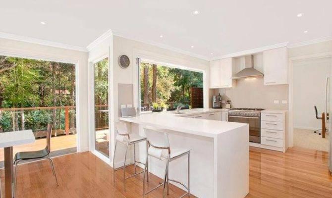 Modern Open Plan Kitchen Design Using Hardwood