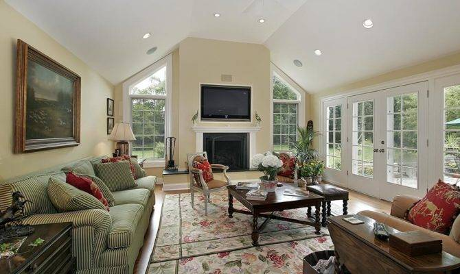 Soft Yellow Walls Warm Living Room Beneath Vaulted Ceiling