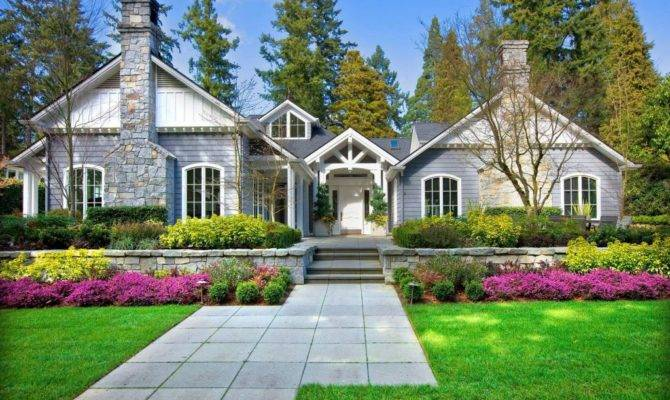 Traditional American Home Gray White Facade Arched Windows