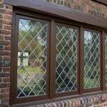 Tudor Style Windows Dark Brown Frame Red